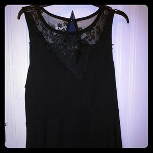 Torrid black peplum top with lace v-neck